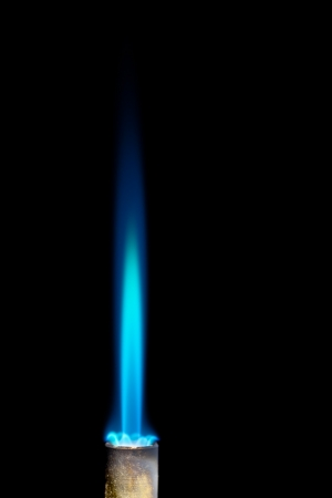 gas fire: Industrial natural gas burner isolated on black background