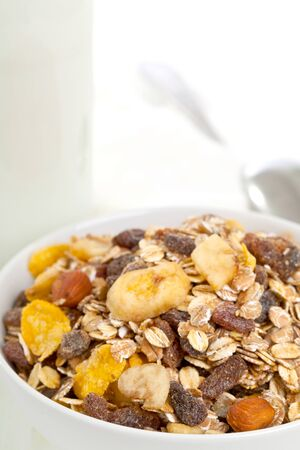 Muesli in bowl with bottle of milk in the background photo
