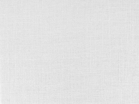 Gros plan de la structure du tissu tissé blanc