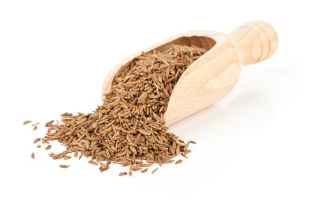 Caraway  Cumin seeds in wooden scoop over white background Stock Photo