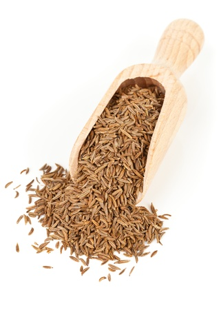 Caraway  Cumin seeds in wooden scoop over white background Archivio Fotografico