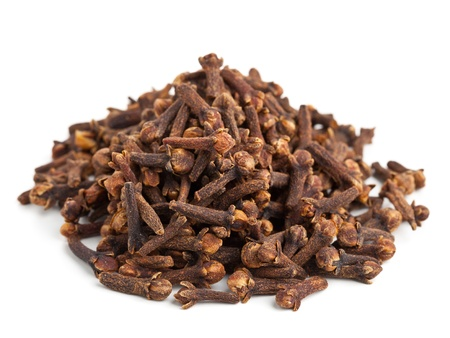 Heap of whole cloves on white background
