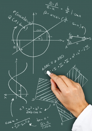 graph theory: Research scientist writing maths diagrams and formulas with chalk on blackboard Stock Photo