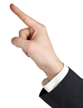 finger pointing: Hand of a businessman pointing upwards isolated on white background