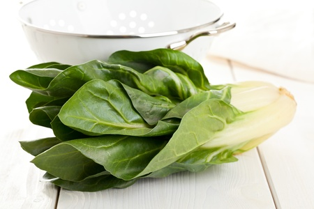 Organic fresh chard plant on kitchen table