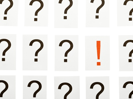 Single exclamation mark between a lot of question marks - solution or idea concept Stock Photo