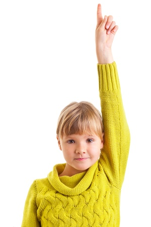 Girl raising hand as she knows the answer photo