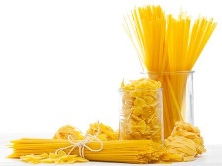 Mixed uncooked raw italian pasta with spaghetti, farfalle and tagliatelle Stock Photo - 17625223