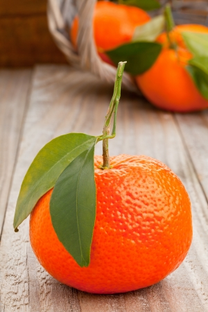 Organic whole tangerines with green leaves on wooden table Stock Photo - 17625232