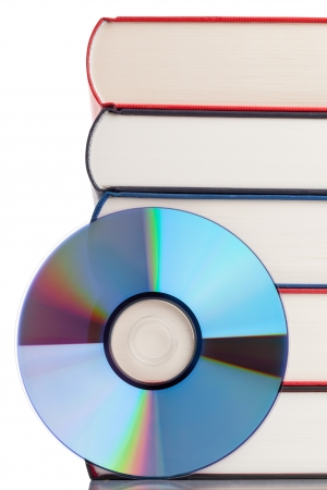 Book with compact disc over white background - e-book or digital storage concept Stock Photo - 17782733