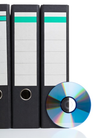 ring binder: Ring binder with compact disc over white background - digital storage concept