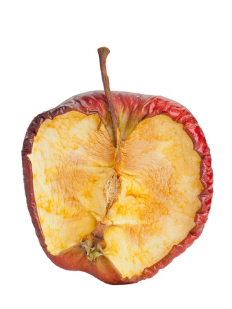 rotten fruit: Half old dry rotten red apple on white background Stock Photo