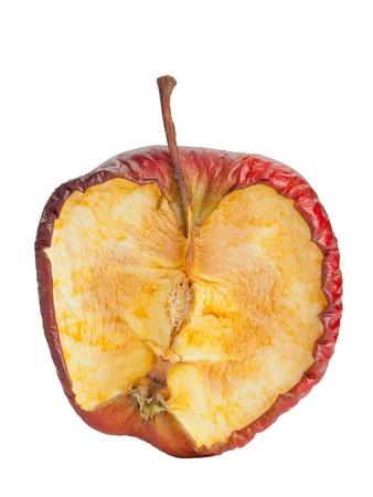 Half old dry rotten red apple on white background Foto de archivo