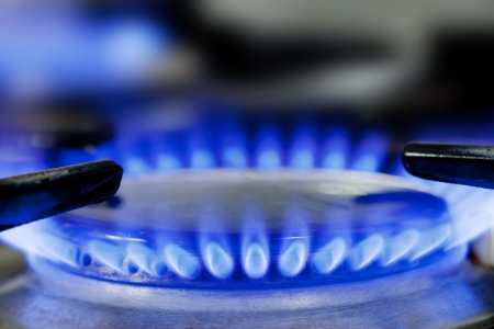 Close up of natural gas stove flames burning Foto de archivo