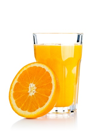 Glass of freshly pressed orange juice with sliced orange half over white background Stock Photo - 18586907
