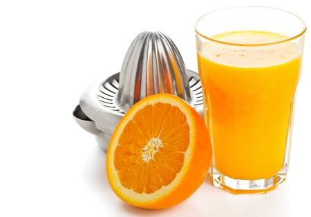 juice squeezer: Glass of freshly pressed orange juice with sliced orange half and juice squeezer over white background