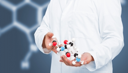 Scientist analyzing chemical molecule model with blue background photo