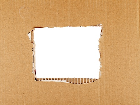 Ripped cardboard with square hole forming frame photo