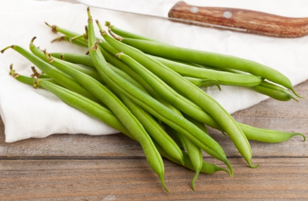Heap of organic pole beans on wooden table Stock Photo - 21580544