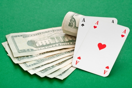 Pocket aces on dollar bills on poker table photo
