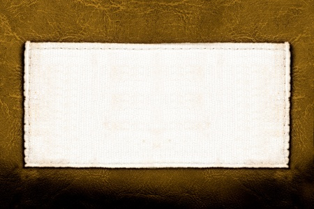 seam: Blank fabric label on leather background close up Stock Photo