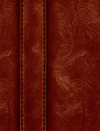 Dark brown colored stitched leather close up with seam
