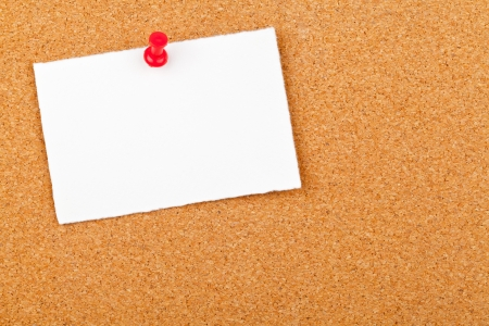 cork sheet: Blank white paper note with red pin on corkboard