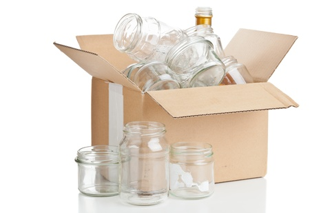 collected: Collected glass bottles in carton box for recycling on white background