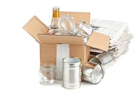 collected: Collected glass bottles, tin cans and newspaper in carton box for recycling on white background