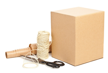 closed box: Brown carton box with packaging materials on white background Stock Photo