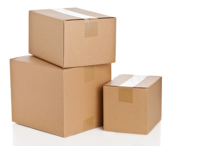 corrugated box: Stacked brown delivery carton boxes on white background