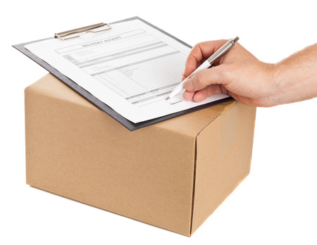 Man signing for delivery on package delivery form on clipboard for delivery on white background Stock Photo - 22944203
