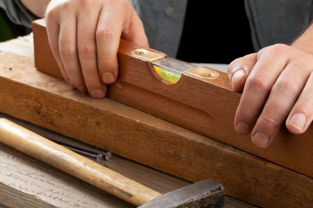 doityourself: Old used water-level on wooden plank - do-it-yourself or artisan concept