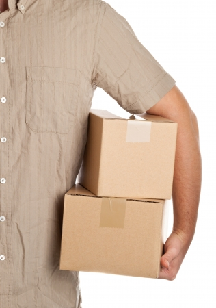 corrugated box: Man holding carton boxes for delivery on white background