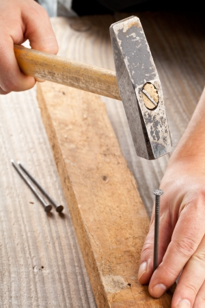 doityourself: Handyman using hammer and nail - woodworking or do-it-yourself concept Stock Photo