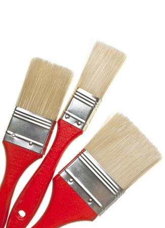 unused: Three unused paint brushes isolated on white background Stock Photo