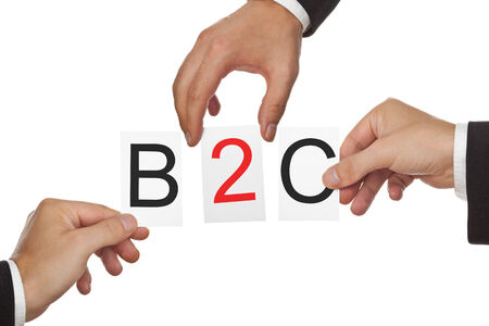 b2c: Hands putting the letters for B2C - business to customer - together