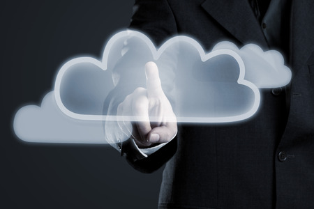 activating: Businessman activating cloud symbol on futuristic touch display Stock Photo