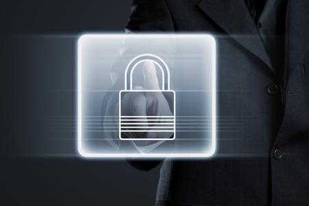 lock  futuristic: Imprenditore premendo il tasto di blocco sul touchscreen futuristico Archivio Fotografico