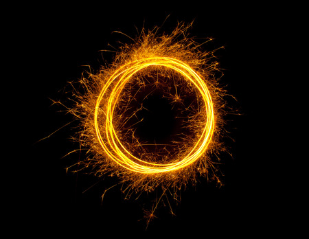Sparkling glowing fire ring isolated on black background photo