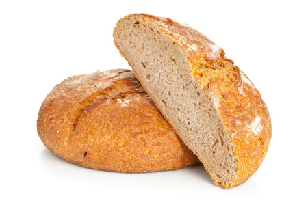 Cut loaf of fresh bread on white background photo