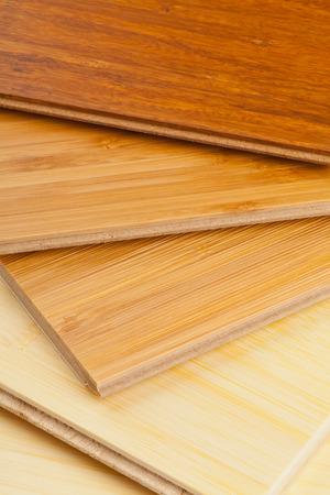 Stack of bamboo laminate flooring samples close up Foto de archivo