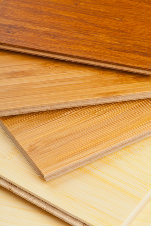Stack of bamboo laminate flooring samples close up Stock Photo