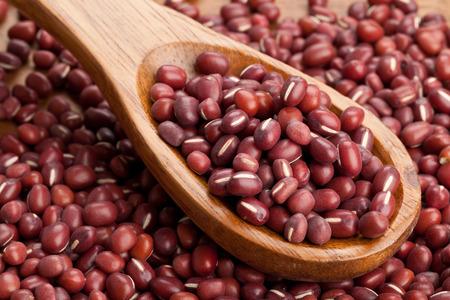 adzuki bean: Raw azuki beans on wooden spoon