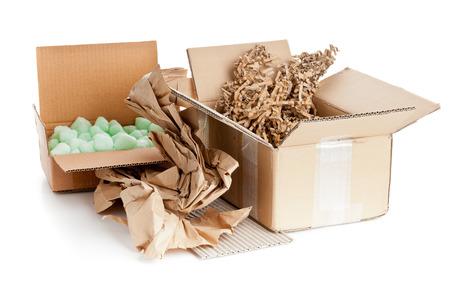 Heap of recyclable packaging materials - cardboard, paper, cornstarch pellets