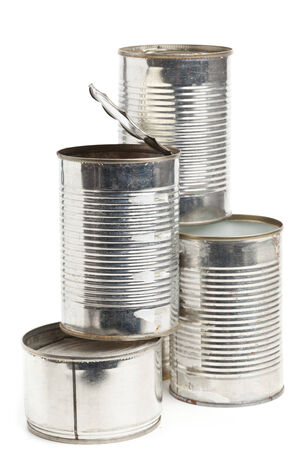 tinned: Empty aluminum cans collected for recycling over white background
