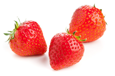 Three ripe whole organic strawberries on white background photo