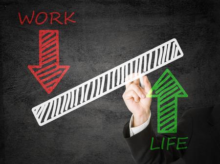 work life balance: Businessman drawing life  work balance scale Stock Photo