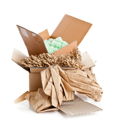 Heap of recyclable packaging materials - cardboard, paper, cornstarch pellets