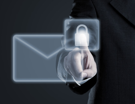 Businessman touching virtual futuristic display with icon for secure email communication